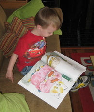 Photo of child engaged with book